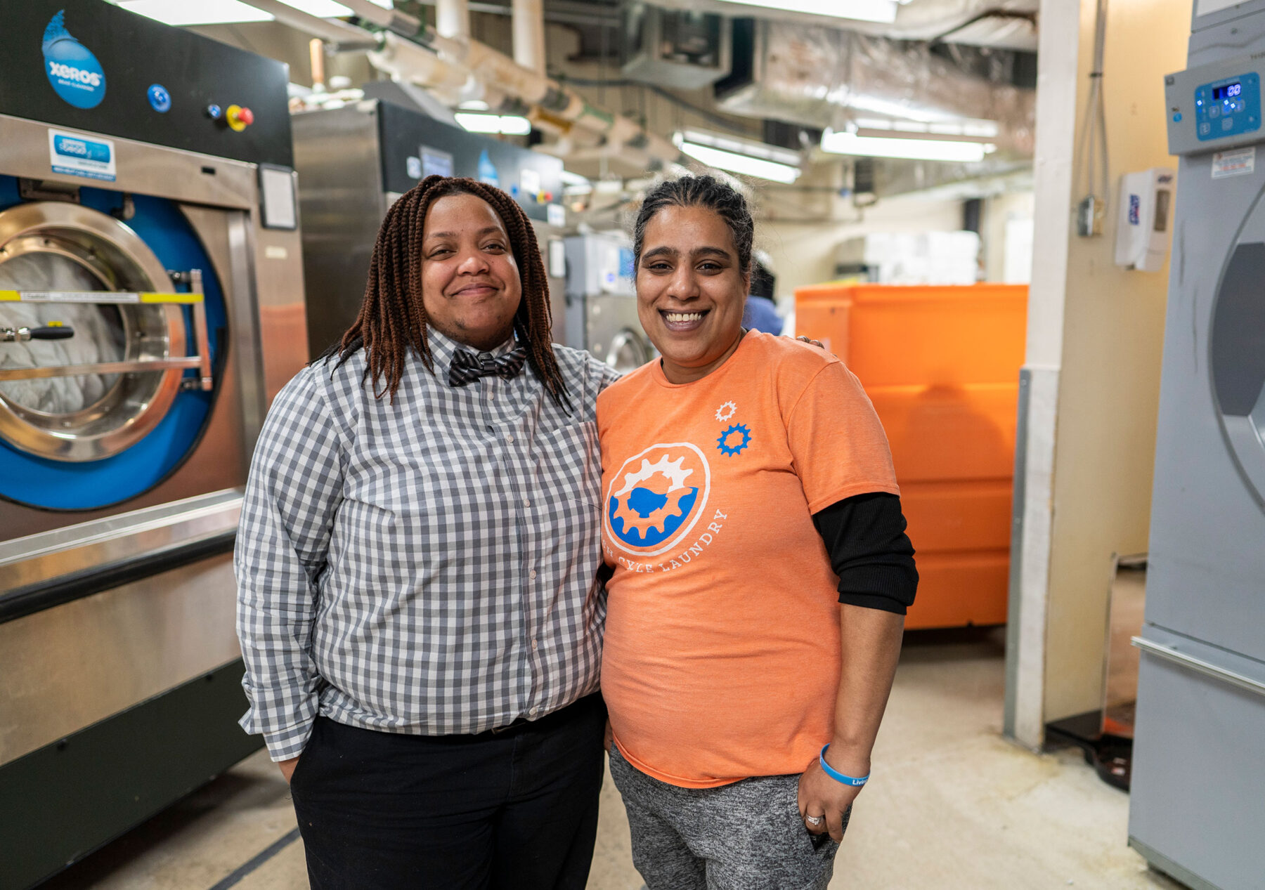 General Manager Shanelle Morton, left, and Plant Manager Luz Adams, right, at Wash Cycle Laundry in Philadelphia. Photo by Jessica Kourkounis