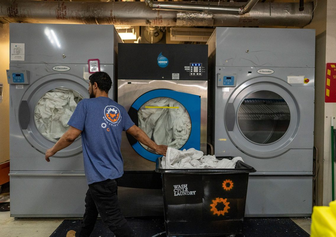 Louie Colon works at Wash Cycle Laundry in Philadelphia. Photo by Jessica Kourkounis