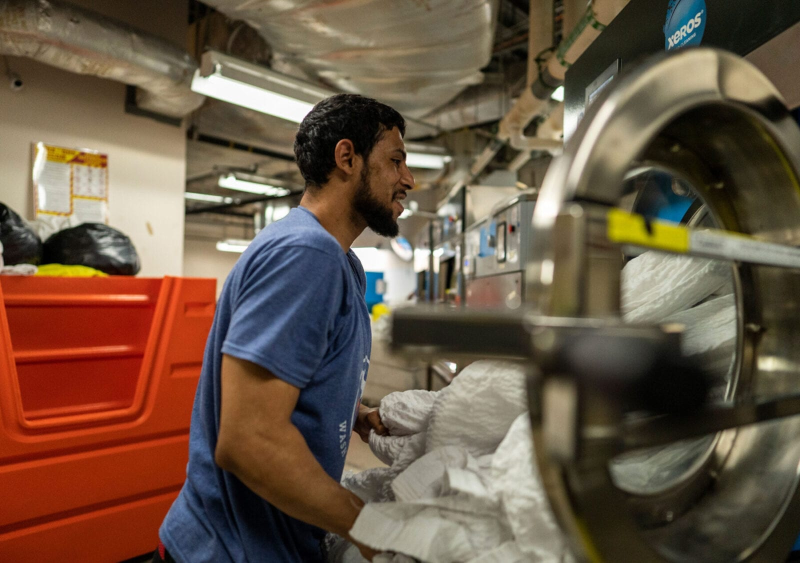 Postindustrial, Louie Colon works at Wash Cycle Laundry in Philadelphia. Photo by Jessica Kourkounis