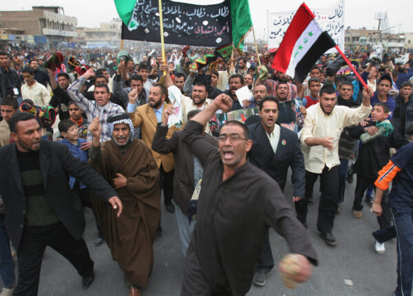 Iraqi Shiites rally for the release of Ahmed al-Shaibany, an aide to radical Shiite cleric Muqtada al-Sadr, after attending Muslim Friday prayers in Al-Sadr city, east of Baghdad, Iraq, Friday Dec. 23, 2005. Sunni Arab and secular Shiite factions demanded that an international body review complaints about voting fraud in last week's elections and threatened to boycott the new legislature. But the United Nations rejected the idea. (AP Photo/Karim Kadim)
